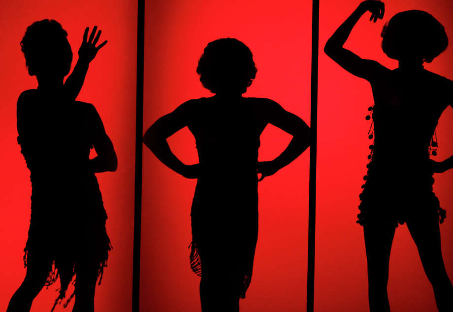 Cast dancers stand in silhouette as George Hamilton stars in La Cage Aux Folles at the Majestic Theatre on May 8, 2012.  Tom Reel/ San Antonio Express-News Photo: TOM REEL, Express-News / San Antonio Express-News