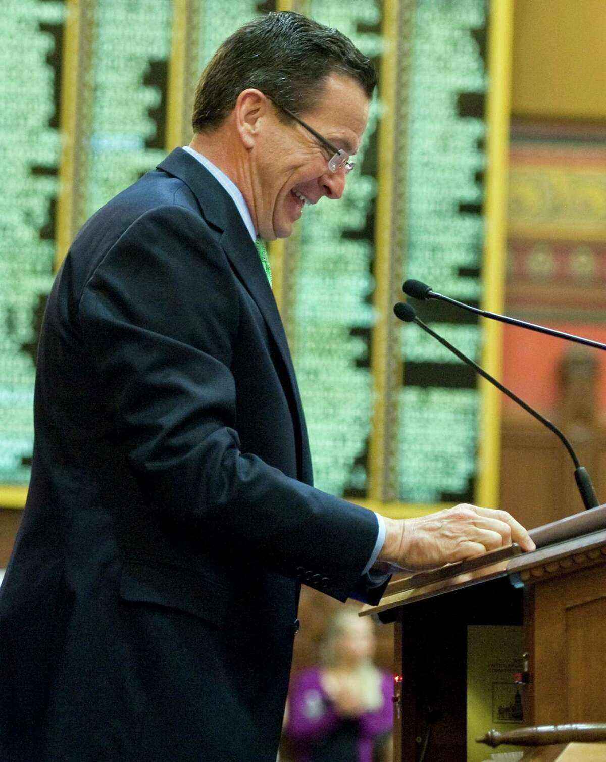 Gov. Dannel P. Malloy smiles as he addresses General Assembly at the end of session the Capitol in Hartford, Conn., Thursday, May 10, 2012. The session resolved several high-profile, perennial issues including the state's death penalty, medical marijuana usage and Sunday alcohol sales.