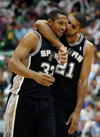Spurs Boris Diaw and Tim Duncan celebrate as they take a commanding lead during the fourth quarter against  the Jazz in Game 3 of the Western Conference first round at EnergySolutions Arena in Salt Lake City,  Saturday, May 5, 2012.  The Spurs won 102-90 and lead the series 3-0. Jerry Lara/San Antonio Express-News Photo: Jerry Lara, Express-News / © San Antonio Express-News