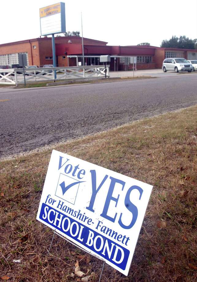 A sign along Burrell-Wingate Road in Fannett shows support for the Hamshire-Fannet I.S.D. school bond election.  Enterprise file photo Photo: Pete Churton