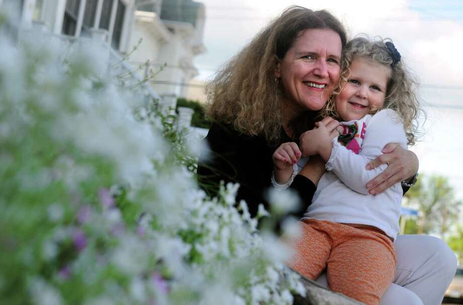 Sue Ellen Powell and her three-year-old daughter, Liza, sit outside their home in the Black Rock section of Bridgeport Thursdsay, May 10, 2012. Photo: Autumn Driscoll / Connecticut Post