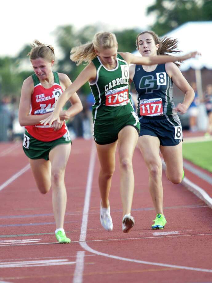 Thao Nguyen/FOR HOUSTON CHRONICLE 05/12/12  Courtney Kriegshauser of Southlake Carrol placed first with Madi McLellan from Conroe The Woodlands in second and Katie Jensen of Conroe Woodlands College Park following behind in third during the girls 1600 meter run at the UIL 5A state track meet at Mike A. Myers Track & Soccer Stadium in Austin, Texas on May 12, 2012. Photo: Thao Nguyen, Houston Chronicle / Thao Nguyen