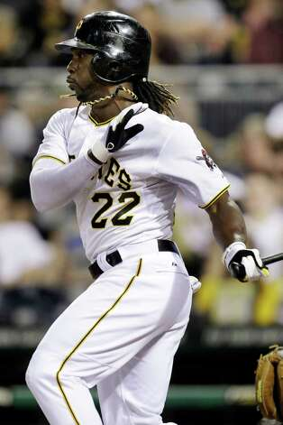 Pittsburgh Pirates' Andrew McCutchen (22) follows through on a single off  Houston Astros pitcher J.A. Happ during the sixth inning of a baseball game in Pittsburgh, Saturday, May 12, 2012. McCutchen went 4 for 4 in a 5-2 Pirates win. Photo: AP