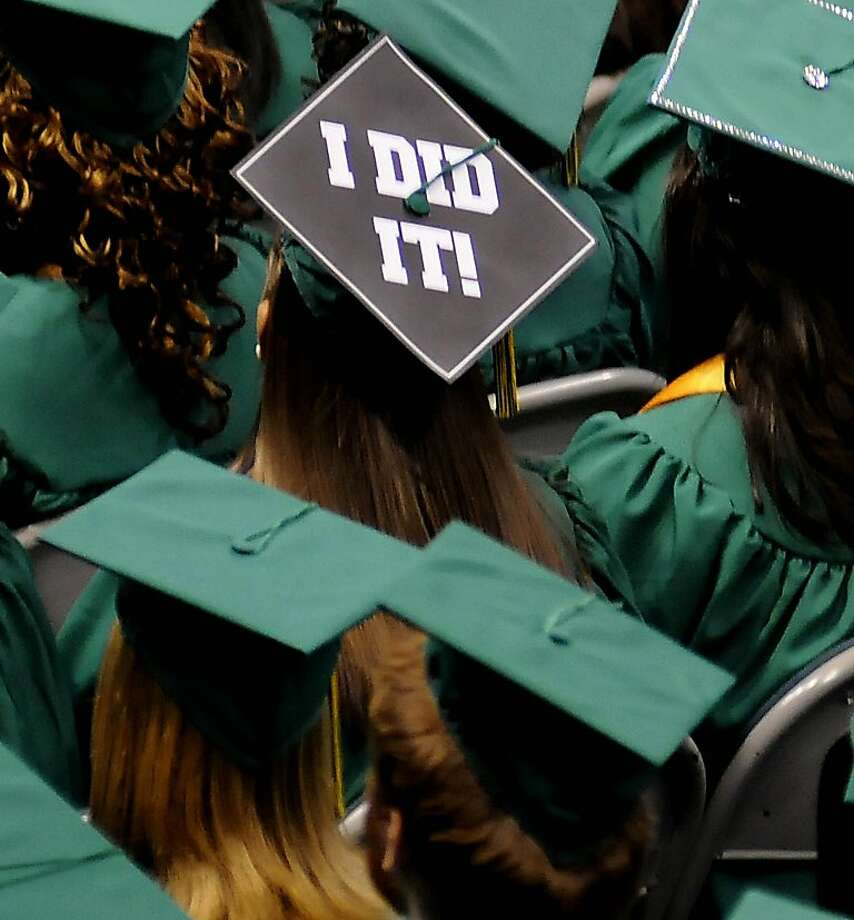 A graduate sends a message on her mortar board cap as the University of Alabama at Birmingham holds May 2012 commencement exercises for their graduates, Saturday, May 12, 2012, in Birmingham, Ala. (AP Photo/Birmingham News, Jeff Roberts) Photo: Jeff Roberts, Associated Press