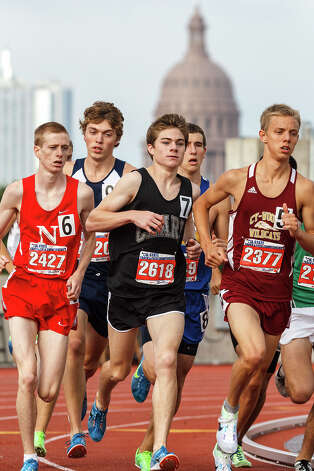 O'Connor's Ryan McCann (second from left) and Clark's Austin Wells (center) run in the 5A boys' 3200-meter run during the UIL state track meet at Mike A. Myers Stadium, University of Texas in Austin on May 12, 2012.  Wells finished fourth with a time of 9:18.17 and McCann fifth at 9:21.64.  MARVIN PFEIFFER/ mpfeiffer@express-news.net Photo: MARVIN PFEIFFER, Express-News / Express-News 2012