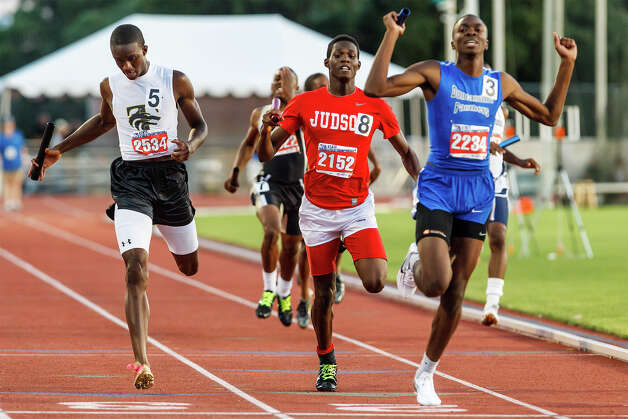 Judson's Jerome Gatewood (center) approaches the finish line between Duncanville's Richard Gary (right) and Mansfield Timberview's Aldrich Bailey as the Rockets take silver in the 5A boys' 1600-meter relay during the UIL state track meet at Mike A. Myers Stadium, University of Texas in Austin on May 12, 2012.  Judson ran a 3:14.63 in the event.  MARVIN PFEIFFER/ mpfeiffer@express-news.net Photo: Express-News