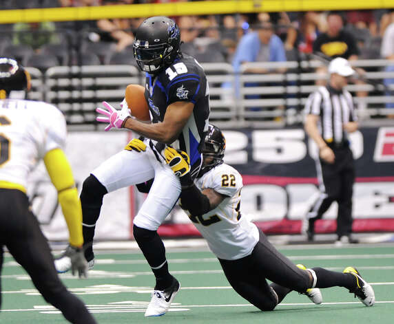 San Antonio Talons' wide receiver Jomo Wilson (15) is dragged down by a Pittsburgh Power's defender during an Arena Football League (AFL) game between the San Antonio Talons and the Pittsburgh Power on May 12, 2012 at the Alamodome in San Antonio Texas. John Albright / Special to the Express-News. Photo: Express-News