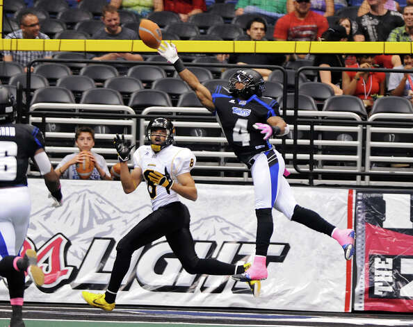 San Antonio Talons defensive back Kenneth Fotenette (4) tips a pass way from Pittsburgh Power's PJ Berry (8) during an Arena Football League (AFL) game between the San Antonio Talons and the Pittsburgh Power on May 12, 2012 at the Alamodome in San Antonio Texas. John Albright / Special to the Express-News. Photo: Express-News