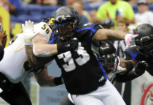 San Antonio Talons' Mark Weivoda (33) breaks through the line of scrimmage as he rushes the quarterback during an Arena Football League (AFL) game between the San Antonio Talons and the Pittsburgh Power on May 12, 2012 at the Alamodome in San Antonio Texas. John Albright / Special to the Express-News. Photo: Express-News