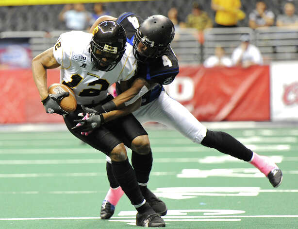 San Antonio Talons defensive back Kenneth Fotenette (4) tackles Pittsburgh Power's Randy Hymes (12) during an Arena Football League (AFL) game between the San Antonio Talons and the Pittsburgh Power on May 12, 2012 at the Alamodome in San Antonio Texas. John Albright / Special to the Express-News. Photo: Express-News