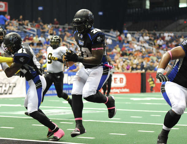 San Antonio Talons' Chad Cook (28) leaps into the endzone for a touchdown during an Arena Football League (AFL) game between the San Antonio Talons and the Pittsburgh Power on May 12, 2012 at the Alamodome in San Antonio Texas. John Albright / Special to the Express-News. Photo: Express-News