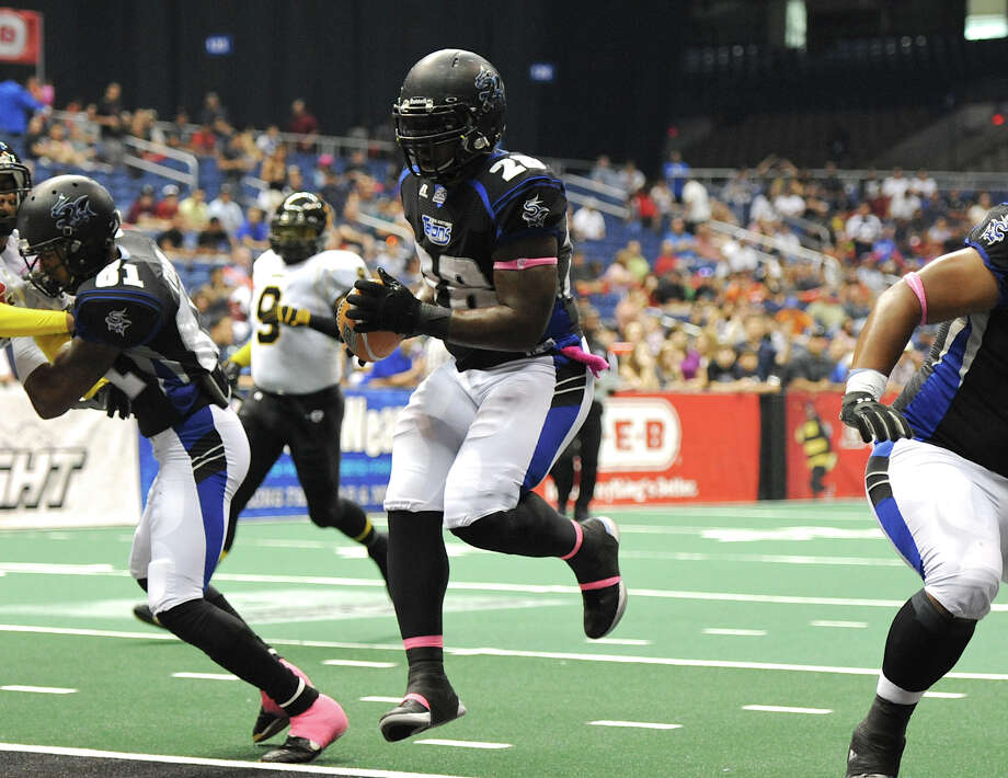 San Antonio Talons' Chad Cook (28) leaps into the endzone for a touchdown during an Arena Football League (AFL) game between the San Antonio Talons and the Pittsburgh Power on May 12, 2012 at the Alamodome in San Antonio Texas. John Albright / For the Express-News. Photo: Express-News