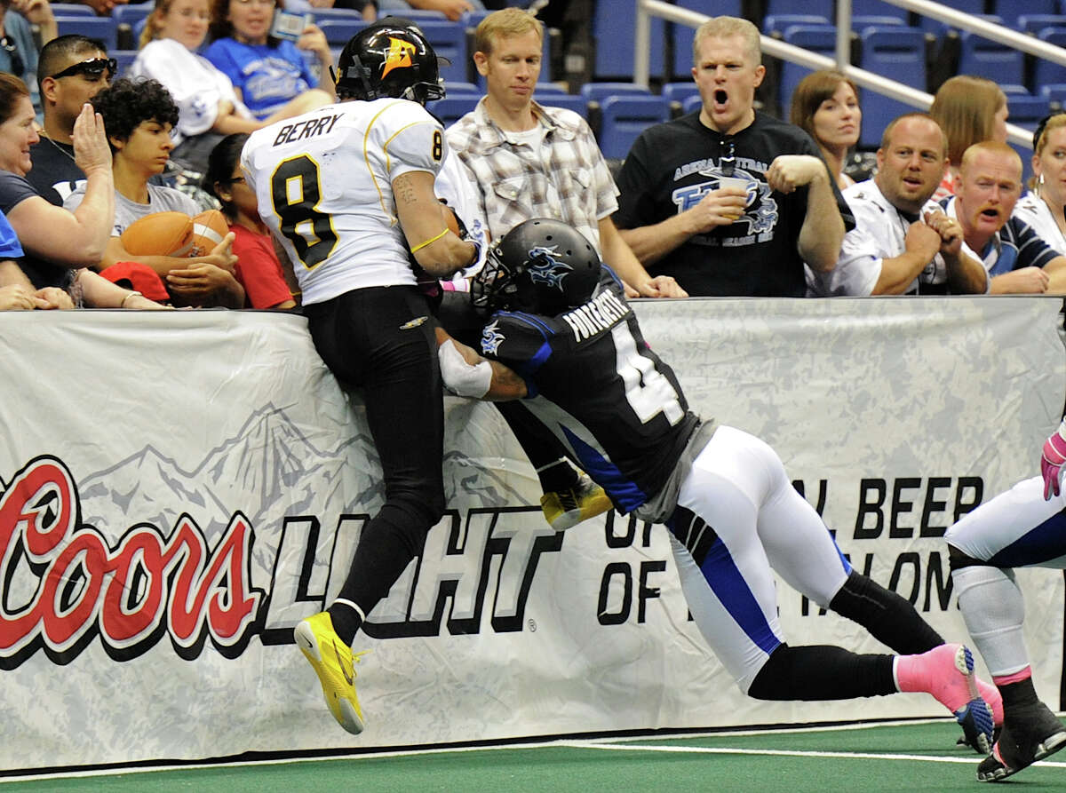 San Antonio Talons' defensive back Kenneth Fontenette (4) knocks Pittsburgh Power wide receiver PJ Berry (8) into the side wall during an Arena Football League (AFL) game between the San Antonio Talons and the Pittsburgh Power on May 12, 2012 at the Alamodome in San Antonio Texas. John Albright / Special to the Express-News.