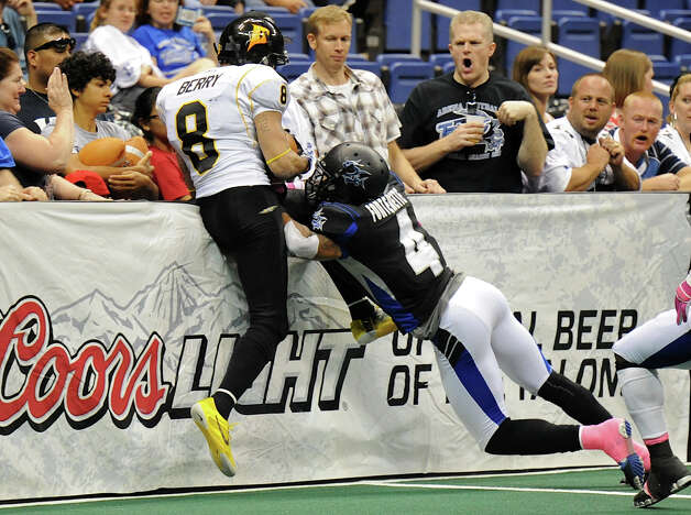 San Antonio Talons' defensive back Kenneth Fontenette (4) knocks Pittsburgh Power wide receiver PJ Berry (8) into the side wall during an Arena Football League (AFL) game between the San Antonio Talons and the Pittsburgh Power on May 12, 2012 at the Alamodome in San Antonio Texas. John Albright / Special to the Express-News. Photo: Express-News