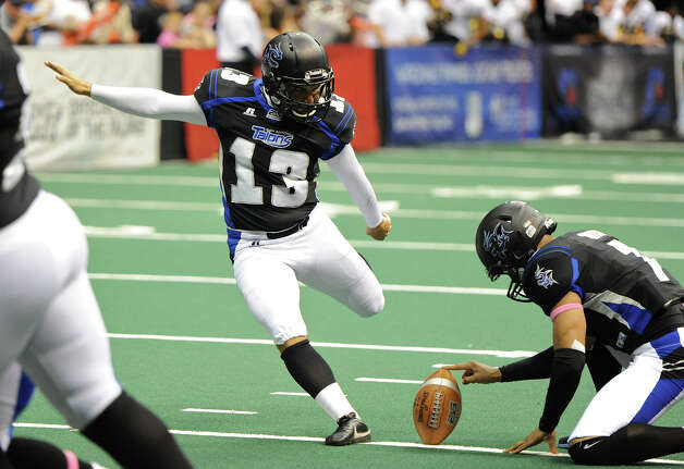 San Antonio Talons' place kicker Stefon Demos (13) kicks a field goal during an Arena Football League (AFL) game between the San Antonio Talons and the Pittsburgh Power on May 12, 2012 at the Alamodome in San Antonio Texas. John Albright / Special to the Express-News. Photo: Express-News