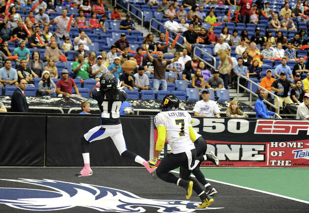 San Antonio Talons' wide receiver Brent Holmes (10) catches a touchdown pass  during an Arena Football League (AFL) game between the San Antonio Talons and the Pittsburgh Power on May 12, 2012 at the Alamodome in San Antonio Texas. John Albright / Special to the Express-News. Photo: Express-News
