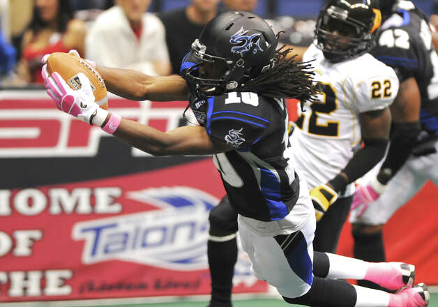 San Antonio Talons' kick returner Brent Holmes (10) leaps into the endzone during an Arena Football League (AFL) game between the San Antonio Talons and the Pittsburgh Power on May 12, 2012 at the Alamodome in San Antonio Texas. John Albright / Special to the Express-News. Photo: Express-News