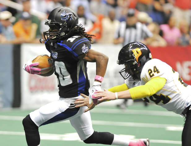 San Antonio Talons' kick returner Brent Holmes (10) breaks past Pittsburg Power's place kicker Seth Burkholder (24) during an Arena Football League (AFL) game between the San Antonio Talons and the Pittsburgh Power on May 12, 2012 at the Alamodome in San Antonio Texas. John Albright / Special to the Express-News. Photo: Express-News