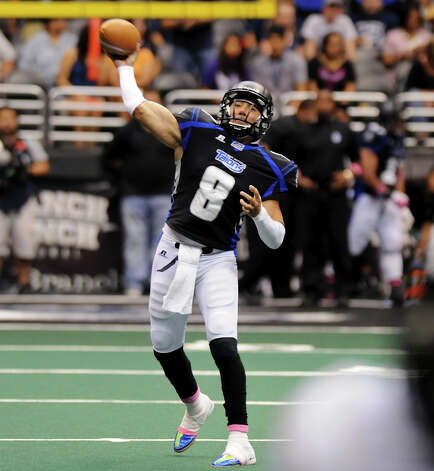 San Antonio Talons quarterback Aaron Garcia (8) throws a touchdown pass during an Arena Football League (AFL) game between the San Antonio Talons and the Pittsburgh Power on May 12, 2012 at the Alamodome in San Antonio Texas. John Albright / Special to the Express-News. Photo: Express-News