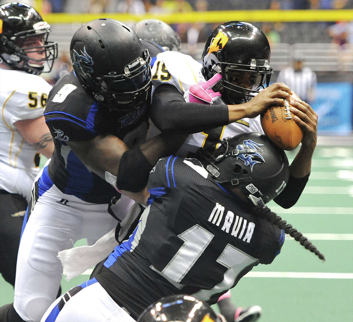 San Antonio Talons' Jerry Brown (9) and Wes Mauia (17) sack Pittsburgh Power quarterback Bryan Randall (19) during an Arena Football League (AFL) game between the San Antonio Talons and the Pittsburgh Power on May 12, 2012 at the Alamodome in San Antonio Texas. John Albright / Special to the Express-News.