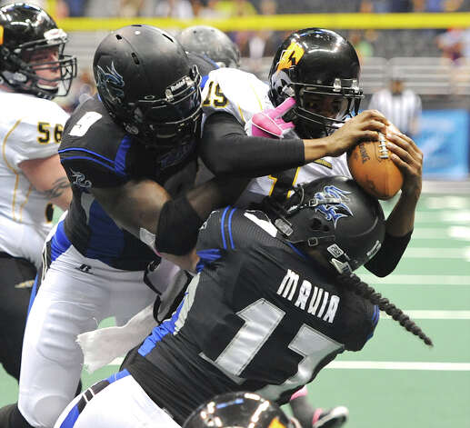 San Antonio Talons' Jerry Brown (9) and Wes Mauia (17) sack Pittsburgh Power quarterback Bryan Randall (19) during an Arena Football League (AFL) game between the San Antonio Talons and the Pittsburgh Power on May 12, 2012 at the Alamodome in San Antonio Texas. John Albright / Special to the Express-News. Photo: Express-News