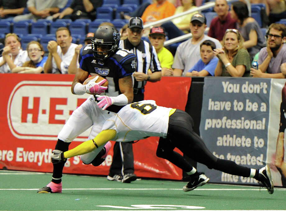 San Antonio Talons' wide receiver Burl Toler (81) tries to get past Pittsburgh Power's Davion Mitchelle (6) during an Arena Football League (AFL) game between the San Antonio Talons and the Pittsburgh Power on May 12, 2012 at the Alamodome in San Antonio Texas. John Albright / Special to the Express-News. Photo: Express-News