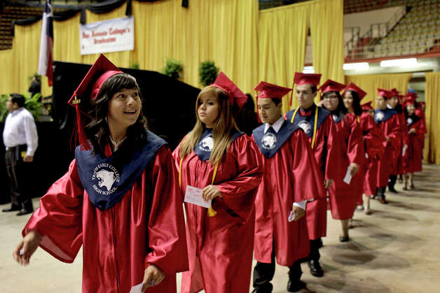 JoAnn Reyes, left, enters the arena with fellow Travis Early College High School students for their graduation with San Antonio College at Freeman Coliseum on Saturday, May 12, 2012. Photo: Lisa Krantz, SAN ANTONIO EXPRESS-NEWS / SAN ANTONIO EXPRESS-NEWS