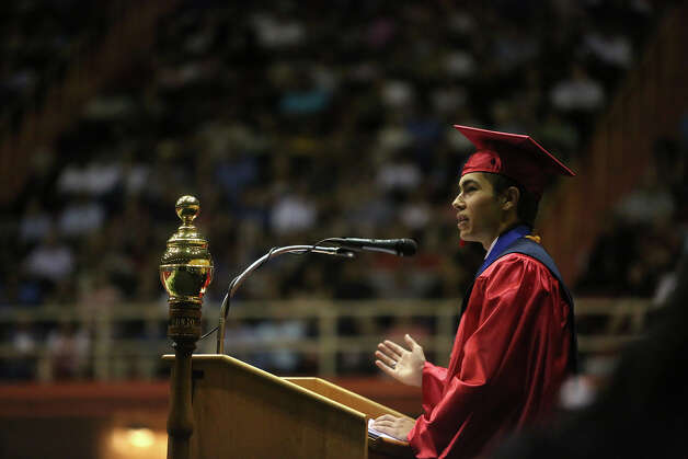 Travis Early College High School valedictorian Andrew De Luna speaks students graduate with San Antonio College at Freeman Coliseum on Saturday, May 12, 2012. Photo: Lisa Krantz, SAN ANTONIO EXPRESS-NEWS / SAN ANTONIO EXPRESS-NEWS
