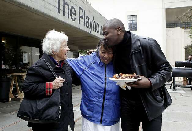 Sylvia Lindsey, (center) gets a hug from artistic dirctor, Robert Battle as he enjoys his meal,  along with her close friend Pat Nottingham.  Lindsey prepares food for the Alvin Ailey dancers after their performance at Zellerbach Hall on the UC Berkeley campus, on Saturday March 17, 2012. 70-year-old Sylvia Lindsey, is famous for throwing southern barbeques for performers. She is a big supporter of African-Americans on stage and in the audience. Photo: Michael Macor, SFC