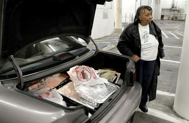 Sylvia Lindsey, waits by her car for a cart to transport all the food which she will prepare for the Alvin Ailey dancers after their performance at Zellerbach Hall on the UC Berkeley campus, on Saturday March 17, 2012. 70-year-old Sylvia Lindsey, is famous for throwing southern barbeques for performers. She is a big supporter of African-Americans on stage and in the audience. Photo: Michael Macor, SFC