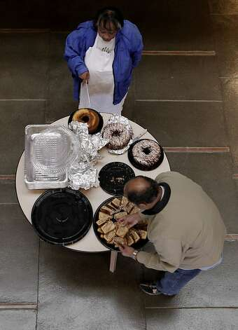 Sylvia Lindsey gets a little help with her homemade cakes from Conrad Sweeting  as they prepare food for the Alvin Ailey dancers after their performance at Zellerbach Hall on the UC Berkeley campus, on Saturday March 17, 2012. 70-year-old Sylvia Lindsey, is famous for throwing southern barbeques for performers. She is a big supporter of African-Americans on stage and in the audience. Photo: Michael Macor, SFC