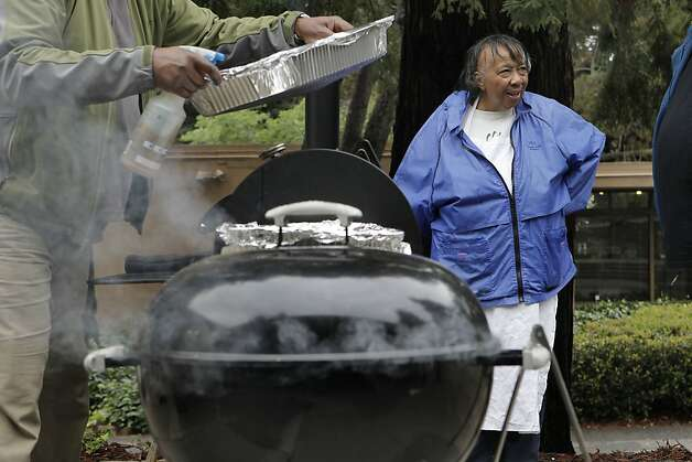 Sylvia Lindsey keeps an eye on things as the crew barbeques food for the Alvin Ailey dancers after their performance at Zellerbach Hall on the UC Berkeley campus, on Saturday March 17, 2012. 70-year-old Sylvia Lindsey, is famous for throwing southern barbeques for performers. She is a big supporter of African-Americans on stage and in the audience. Photo: Michael Macor, SFC