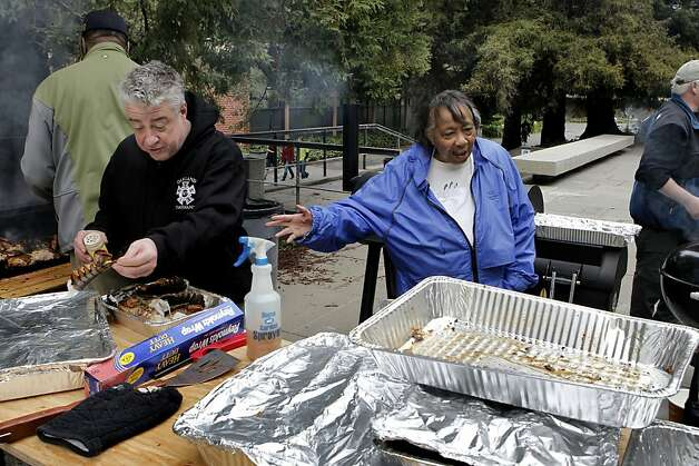Sylvia Lindsey and Technical Director E.J. Corrigan, (left) as the crew barbeques food for the Alvin Ailey dancers after their performance at Zellerbach Hall on the UC Berkeley campus, on Saturday March 17, 2012. 70-year-old Sylvia Lindsey, is famous for throwing southern barbeques for performers. She is a big supporter of African-Americans on stage and in the audience. Photo: Michael Macor, SFC