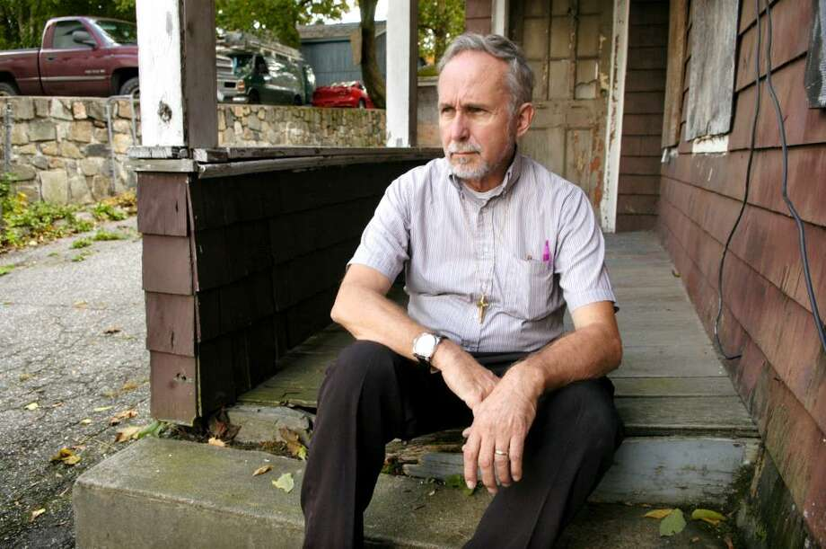 """Deacon Michael J. Oles is the founder of """"Off the Streets Now."""" Photo: Carol Kaliff / The News-Times"""