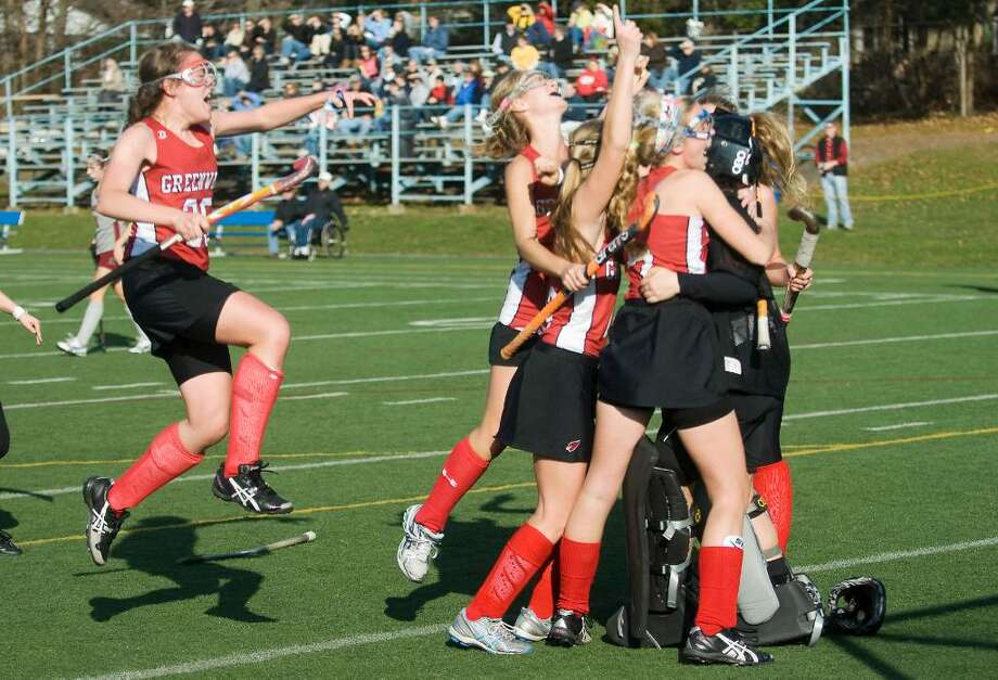 Greenwich field hockey team celebrates after defeating  Pomperaug in the Class L field hockey championship game at Wethersfield High School in Wethersfield, Conn.  on Saturday, Nov. 21,   2009. Photo: Kathleen O'Rourke / Stamford Advocate