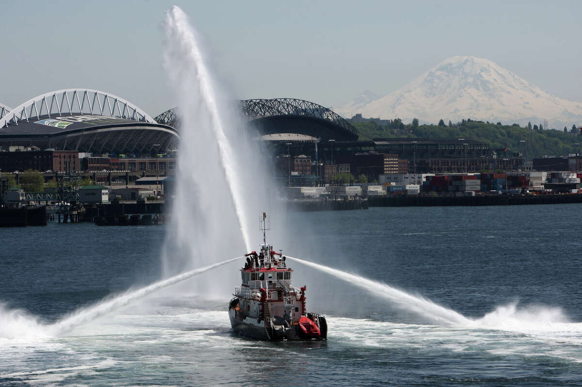 The Seattle Fire Department Boat Leschi shows what its water cannons are capable of during the Vigor Seattle Maritime Festival along the Seattle waterfront on Saturday, May 12, 2012. The annual event features a boat building competition and race, demonstrations and popular tugboat races.