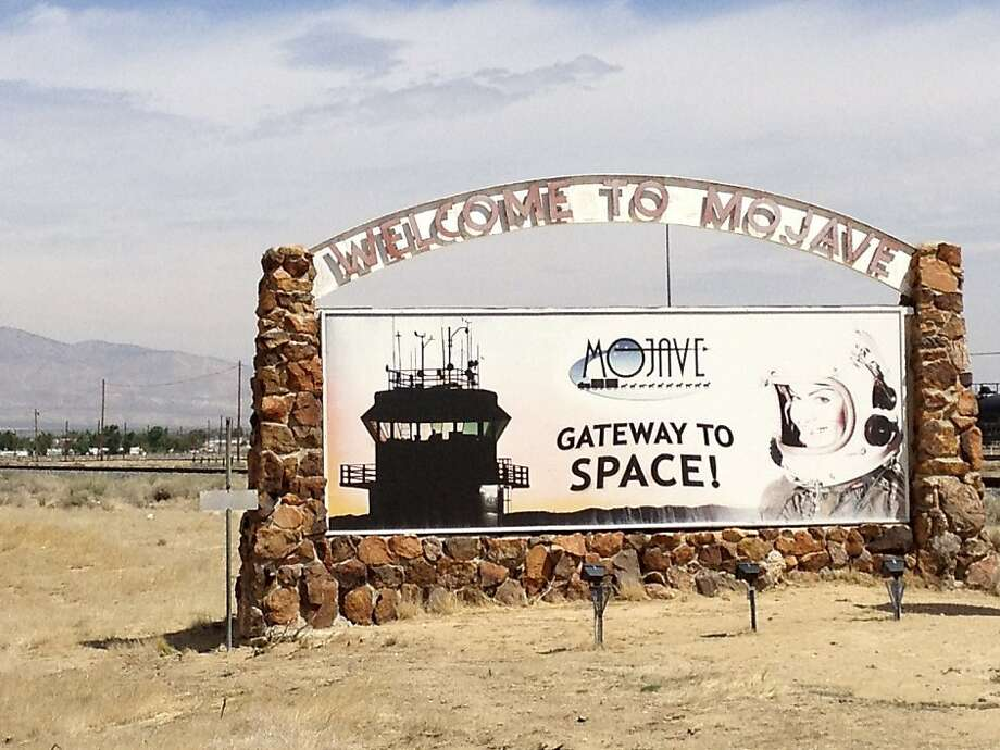 A welcome sign at the Mojave Air and Space Port, where Virgin Galactic conducts flight tests of SpaceShipTwo, in Mojave, Calif., April 24, 2012. Entrepreneurs at a mix of aerospace companies based at the air and space port are among those thought to be leading the next phase of space exploration. (Kenneth Chang/The New York Times) Photo: Kenneth Chang, New York Times