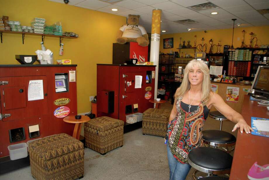 Tracey Scalzi, who owns smoke shops in Norwalk and Orange called Tracey's Smoke Shop and Tobacco LLC, at the Norwalk, Conn. location on Friday May 11, 2012.  The state is trying to force her to pay cigarette taxes on roll-your-own smokes, either in court or through legislation. Photo: Dru Nadler / Stamford Advocate Freelance