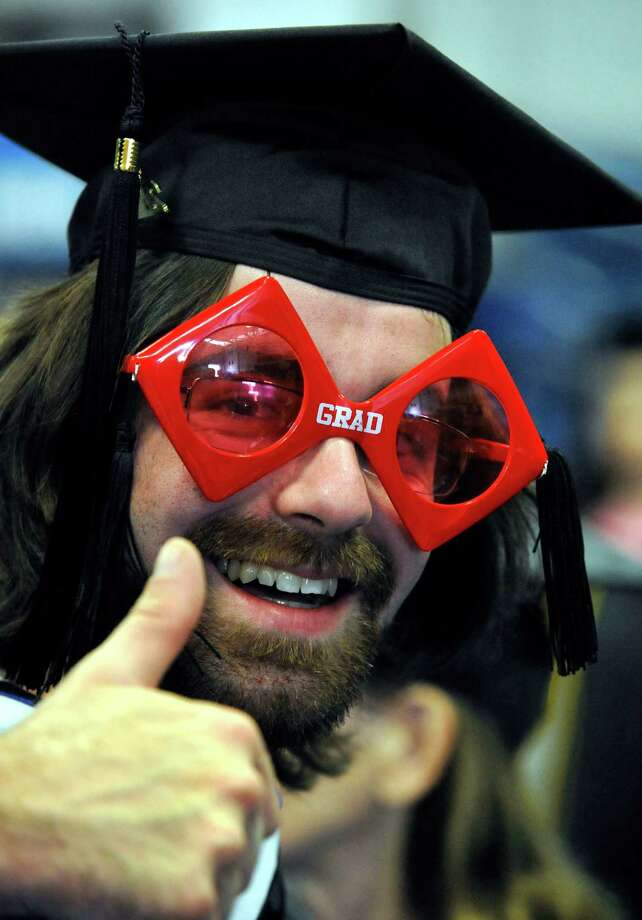 Kevin Jones of Bethel celebrates his graduation during the 114th Commencement Exercises of Western Connecticut State University in Danbury Sunday, May 13, 2012. Photo: Michael Duffy / The News-Times