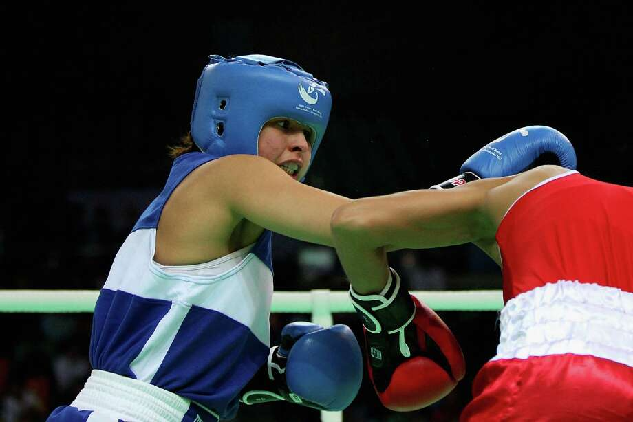 QINHUANGDAO, CHINA - MAY 13:  Marlen Esparza (Blue) of the United States fights against Pamela Benavidez (Red) of Argentina in the Women's 51kg preliminary match during the AIBA Women's World Boxing Championships on May 13, 2012 in Qinhuangdao, China. The AIBA Women's World Boxing Championships 2012 which is a London Olympic Games Qualifying Event will be held from May 11 to 19. Photo: Feng Li, Getty Images / 2012 Getty Images