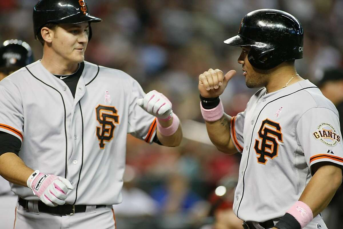 PHOENIX, AZ - MAY 13: Brett Pill #6 of the San Francisco Giants is congratulated by teammate Melky Cabrera #53 following his two-run home run against the Arizona Diamondbacks during the fifth inning of a MLB game at Chase Field on May 13, 2012 in Phoenix, Arizona. (Photo by Ralph Freso/Getty Images)