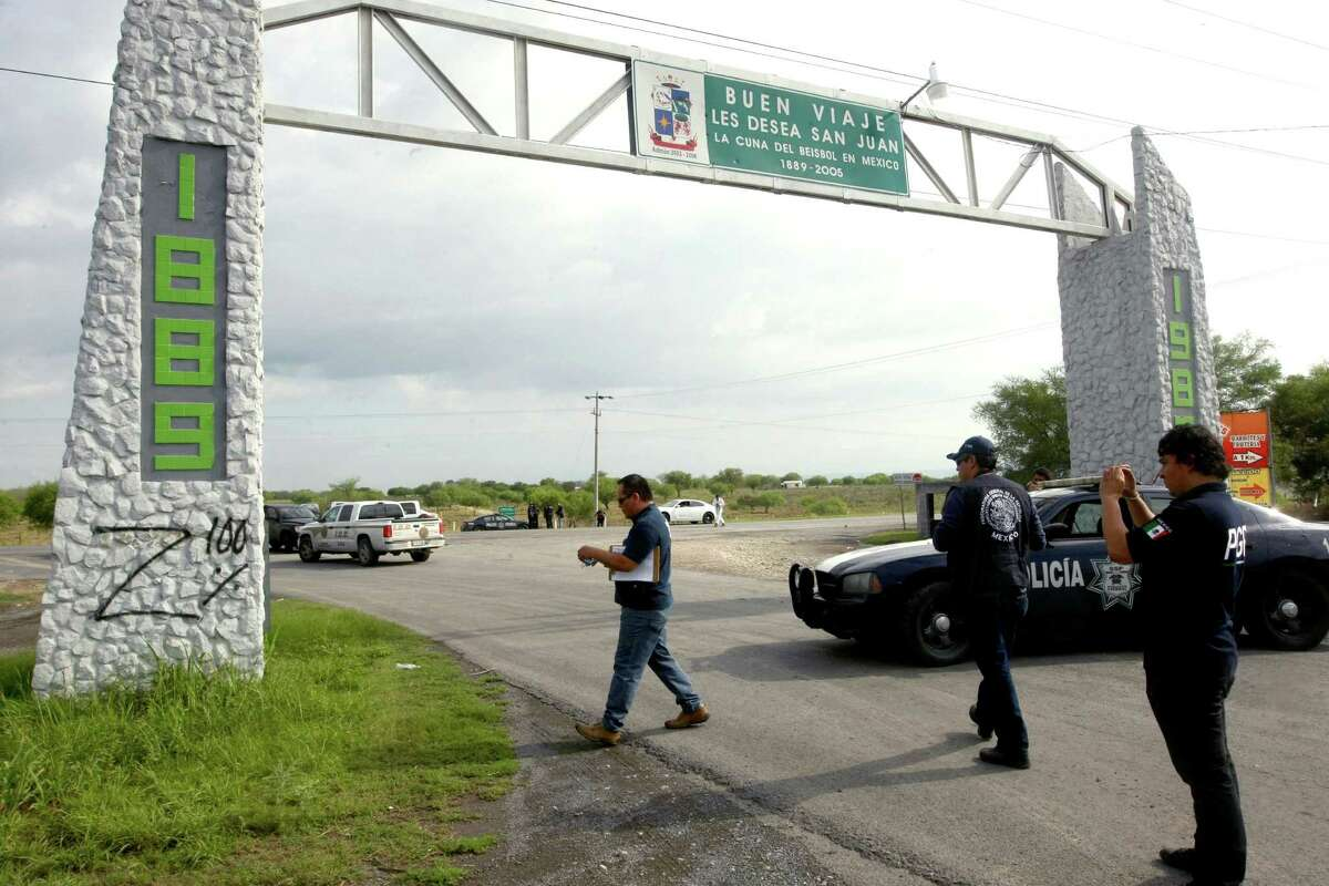 Forensic investigators photograph graffiti reading