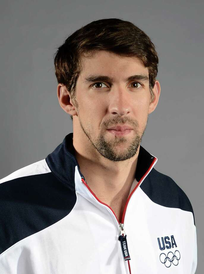 Michael Phelps of the US Olympic Swimming team poses for pictures during the 2012 Team USA Media Summit on May 13, 2012 in Dallas,Texas.AFP PHOTO/JOE KLAMARJOE KLAMAR/AFP/GettyImages Photo: JOE KLAMAR, AFP/Getty Images / AFP