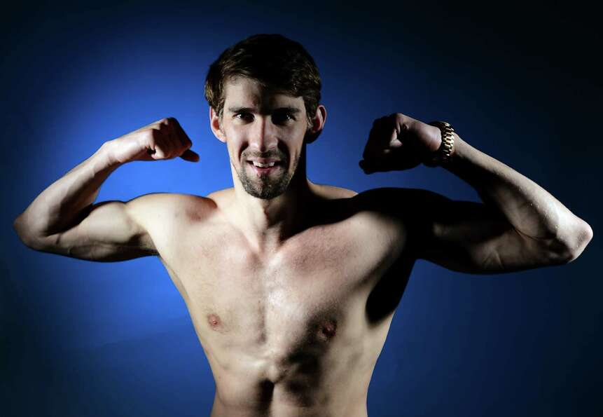 Michael Phelps of the US Olympic Swimming team poses for pictures during the 2012 Team USA Media Sum