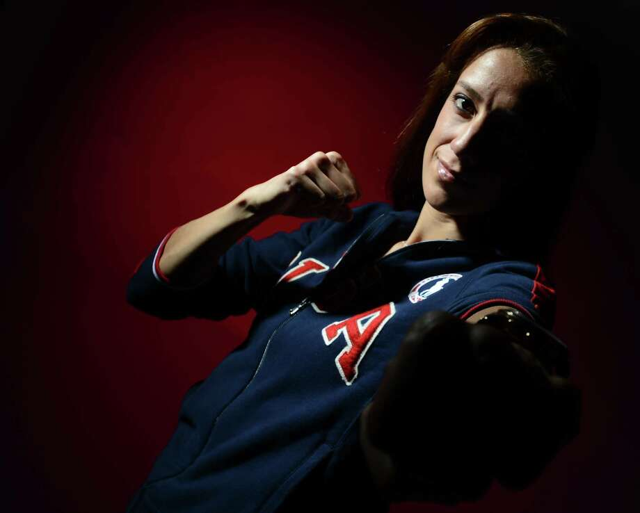 Diana Lopez of the US Taekwondo Olympic team poses for pictures during the 2012 Team USA Media Summit on May 13, 2012 in Dallas,Texas.AFP PHOTO/JOE KLAMARJOE KLAMAR/AFP/GettyImages Photo: JOE KLAMAR, AFP/Getty Images / AFP