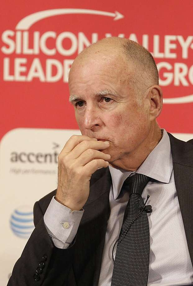 California Gov. Jerry Brown listens as Colorado Gov. John Hickenlooper speaks at a panel at the Silicon Valley Leadership Group's 9th Annual CEO Business Climate Summit in San Jose, Calif., Tuesday, April 24, 2012. (AP Photo/Jeff Chiu) Photo: Jeff Chiu, Associated Press