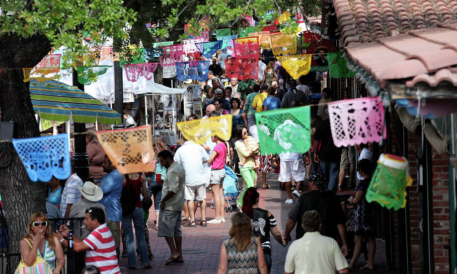 Crowds meander through Market Square Sunday May 13, 2012 during the Mother's Day Week-end Celebration. Photo: EDWARD A. ORNELAS, SAN ANTONIO EXPRESS-NEWS / © SAN ANTONIO EXPRESS-NEWS (NFS)