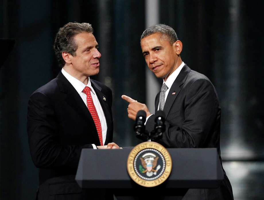 President Barack Obama acknowledges New York Gov. Andrew Cuomo after being introduced at the University at Albany's College of Nanoscale Science and Engineering in Albany, N.Y., Tuesday, May 8, 2012.  (AP Photo / Mike Groll) Photo: Mike Groll / AP