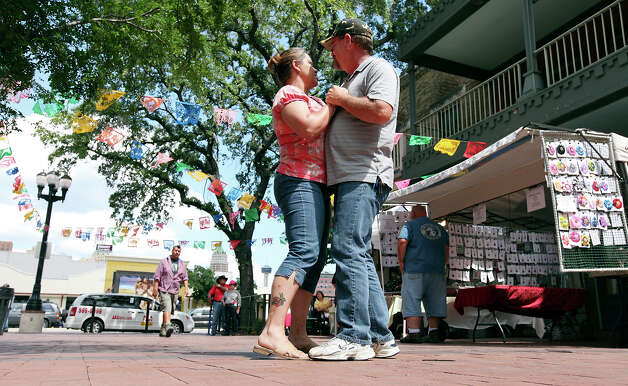 Laurie (left) and Eric Allen dance in Market Square Sunday May 13, 2012 during the Mother's Day Week-end Celebration. Photo: EDWARD A. ORNELAS, SAN ANTONIO EXPRESS-NEWS / © SAN ANTONIO EXPRESS-NEWS (NFS)