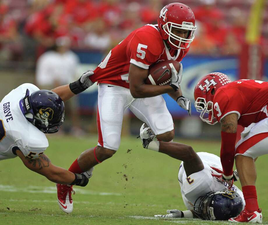 Houston's Charles Sims (5) will be a senior when the Cougars and three other C-USA schools move into the Big East in 2013. Photo: Nick De La Torre / © 2011  Houston Chronicle